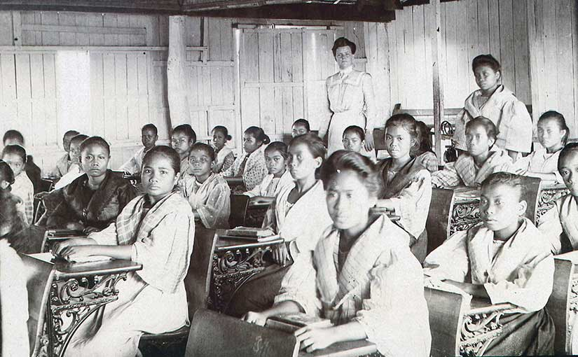 An American teacher, Mary Scott Cole, is pictured with her class in Palo, Leyte. Photo from the University of Michigan Bentley History Library.
